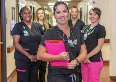 Copper Ridge staff smiling and standing in hallway