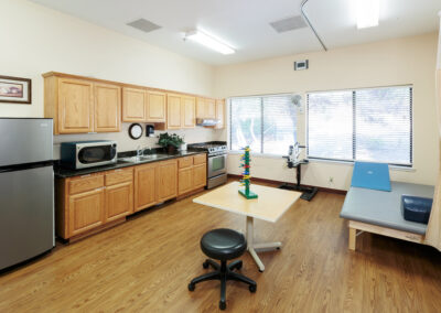 Small room with exercise equipments and kitchen