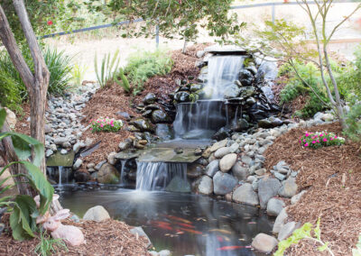 Beautiful three tiered waterfall with koi fishes