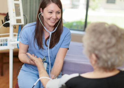 Nurse taking blood pressure of an elderly