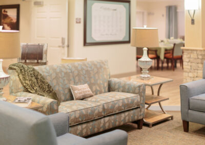 a comfortable lobby area with couches and chairs