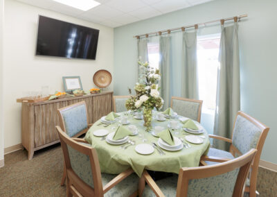 Dining table set for six with a lovely green and white floral centerpiece
