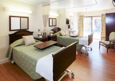 Private room with double beds and access to courtyard