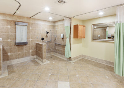 Spacious shower room with curtains for privacy