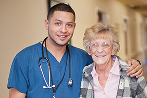 Nurse hugging patient in facility