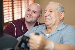 patient and nurse smiling during rehabilitation