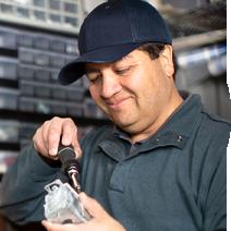 A man fixing a broken item.