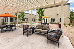 A large outdoor pergola with several options for seating.