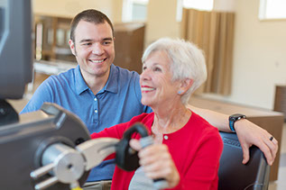 A patient smiling while performing rehabilitation exercises.