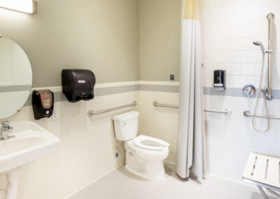 Resident bathroom with handicap accessibility features for resident safety.