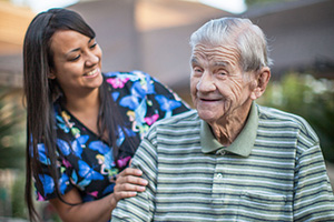 Nurse embracing a patient smiling making patient laugh