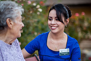 Healthcare worker smiling with patient outside