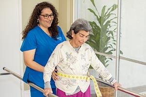 senior woman with a rehab therapist Rehab gym