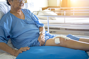 elderly patient with a leg wound bandage