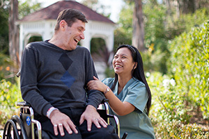 University Care Center outside courtyard, caregiver and resident